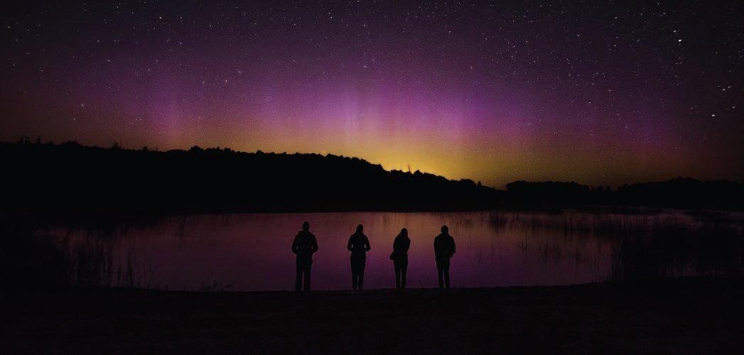 My friends in front of very weak aurora display. Veleniškiai quarry, Biržai region. (August 2015.)