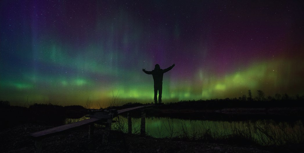 Me standing in front of very strong aurora display. The light seemed to penetrate my entire body. Veleniškiai quarry, Biržai region. March, 2015.