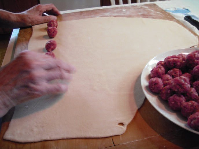 Mass production! Laying out the meatballs on the assembly line.