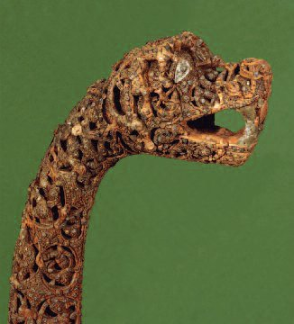 Typical serpent prow from a Viking ship. Museum of Cultural History, University of Oslo, Norway. Source: Wikipedia: Oseberg_ship_head_post.jpg