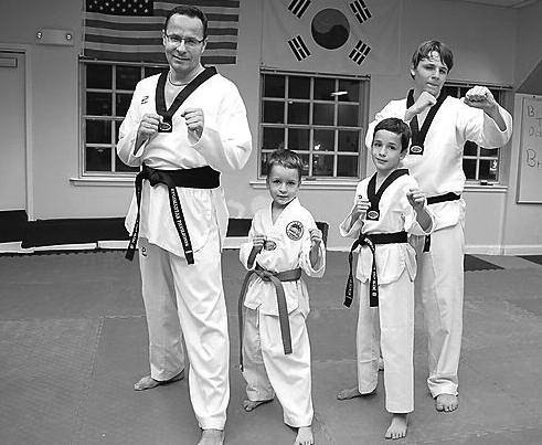 Black belt Ambassador Žygimantas Pavilionis with his sons Vincentas, Simonas, and Dominykas.