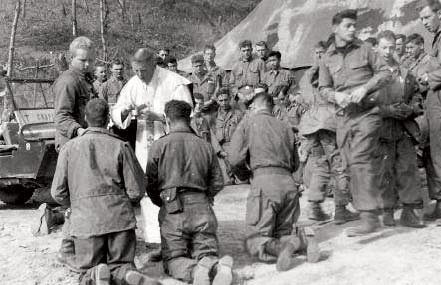receiving Holy Communion in the war zone.