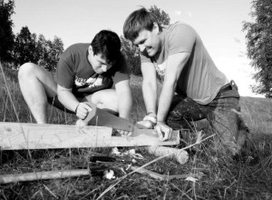Donatas Barsys and Tomas Staniulis constructing a cross.
