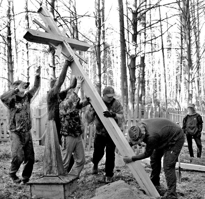 Many hands make for light work. Mission: Siberia team members erect a cross in honor of Lithuanian deportees in the Tomsk region of Russia.