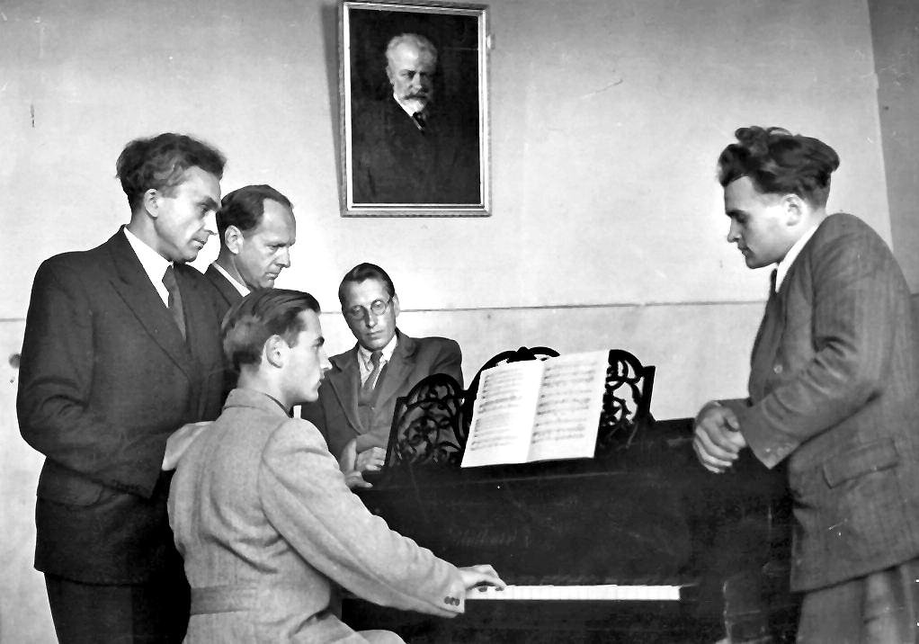 Around the piano at the Lithuanian Academy of Music and Theatre. Juozas Gruodis is far right.