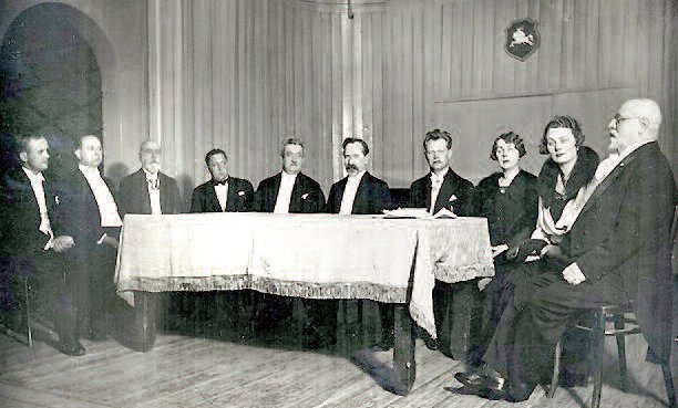 Kaunas Conservatory opening ceremony in 1933. From left to right: Vladas Motekaitis, Antanas Kačanauskas, Juozas Naujalis, Viktoras Žadeika, Konstantinas Šakenis, Antanas Smetona, Juozas Gruodis, Elena Laumenskienė, Vladislava Grigaitienė, Jazeps Vitols.