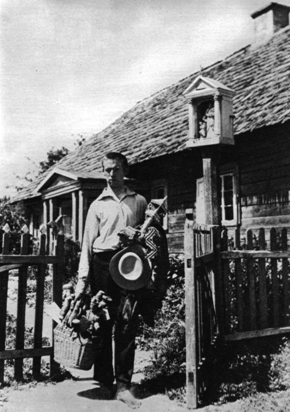Balys as a young man carrying works of folk art in Sidariai.
