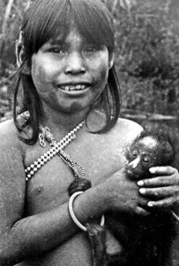 In Amazonia, little girls play with tamed wild animals instead of dolls. This Urudan girl holds a baby spider monkey. Other popular pets include the raccoon-like coati mundi, terecay turtles, and various birds. Rondonia, Brazil, 1973.