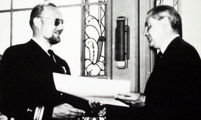 Honored for stopping epidemics in South America. Bolivian Defense Minister A. Crespo (r.) presents Dr. F. A. Bendoraitis with the Naval Merit Medal and a Lt. Commander's commission in Bolivia's Riverine Navy's Medical Corps. (Bolivia is landlocked.) Dr. Bendoraitis also received an honorary Bolivian citizenship in 1967