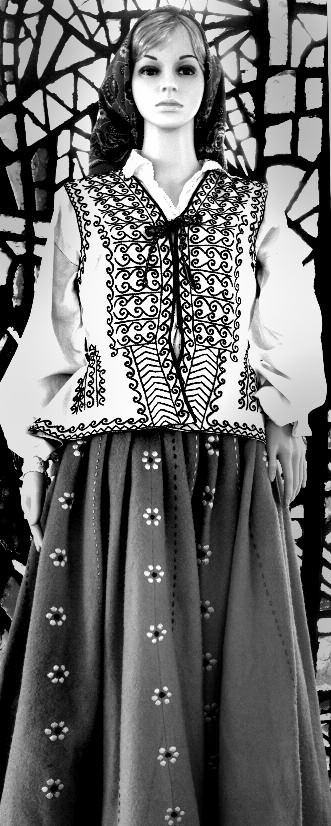 A Latvian national costume hand sewn from tablecloths. A poignant remembrance.