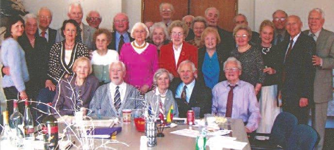 2006 reunion of former Lithuanian students, with wives and guests. From left to right. First row: Ona Tunkūnaitė, Eugenijus Gerulis, Mrs. D. Bendikas, Jurgis Bendikas, Pranas Jurkus. Second row: Lilė Juozaitis, Danutė Eidukas, Marion Karalis, Eugenija Barškėtis, Karolina Kubilius, Aldona Čepėnas, Irena Levickas, Mrs. Miknaitis, Mrs. Baukus and Mindaugas Baukus. Third row: Mrs. Skiotys, Leonas Maskaliunas, E. Eidukas, Ed. Skiotys, V. Lapatinskas, (hard to see) A. Lingis, (high up with glasses) Vytautas Černius, (hard to see) Eligijus Kaminskas. Zigmas Jakimčius, R. Butkūnas, Sigtas Miknaitis, V. Čepėnas.